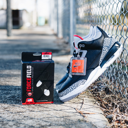 ed40b3c9cda Air Jordan 3 Black Cement on sidewalk next to box of ForceField Crease  Preventers